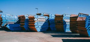 Collection of CSH Environmental skips stood in yard